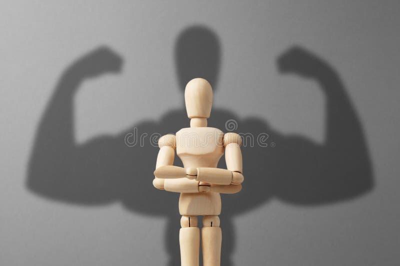 Biznesmen postać z silnym cieniem Pojęcie władza w biznesie obraz stock