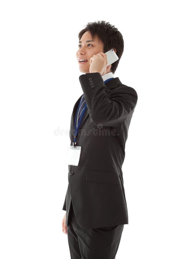 Biznesmen pracuje z smartphone zdjęcie stock