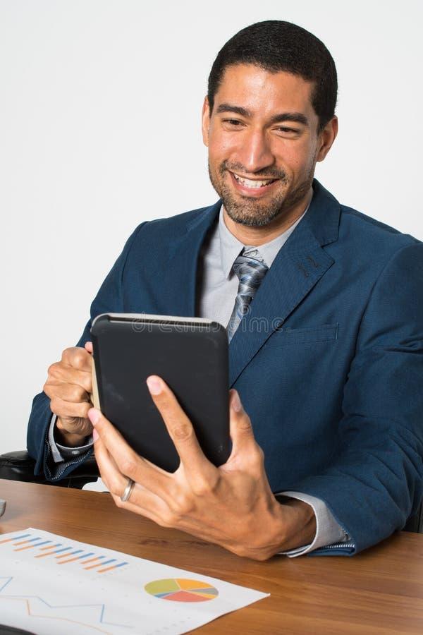 Biznesmen przy biurem fotografia stock