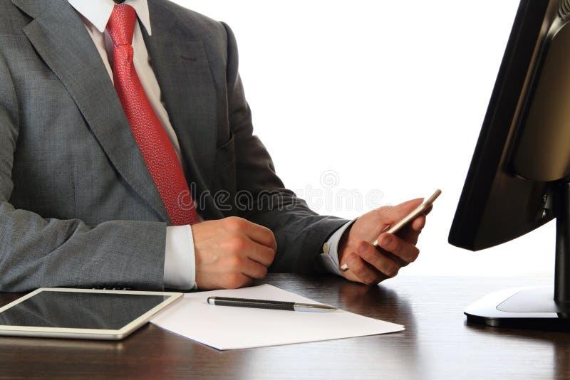 Biznesmen przy pracującym miejscem zdjęcie royalty free
