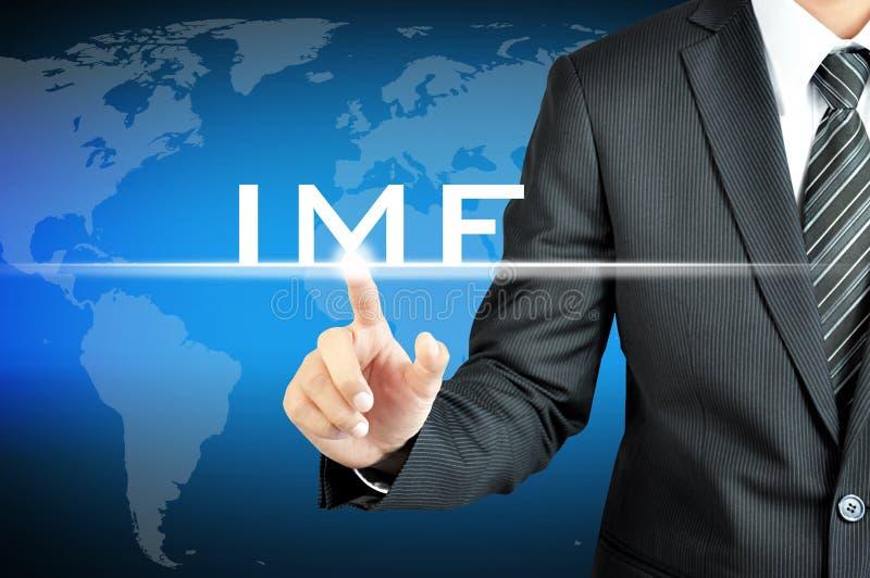 Biznesmen ręka wskazuje IMF znak (Międzynarodowy fundusz monetarny) ilustracja wektor