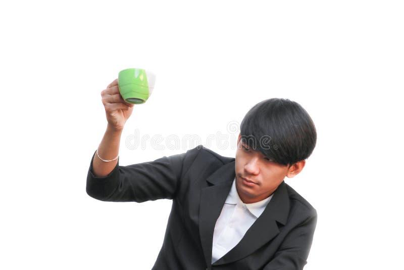 Biznesmen ręki chwyt wysyła filiżankę na białym tle zdjęcie stock