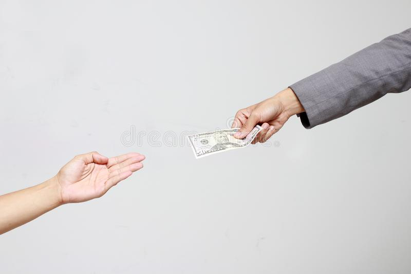 Biznesmen ręki mienia dolar amerykański, USD rachunki oferta banknotu dolarowy pieniądze i dawać pieniądze, Płacili dla Coś obok  fotografia stock