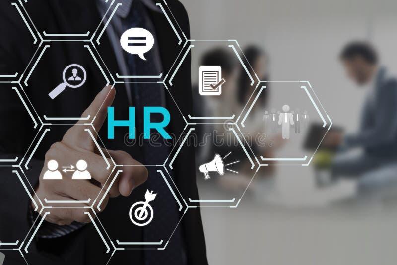 Biznesmen ręki odciskania guzika działy zasobów ludzkich znak na wirtualnym ekranie HR zarządzania Rekrutacyjny Zatrudnieniowy po fotografia stock
