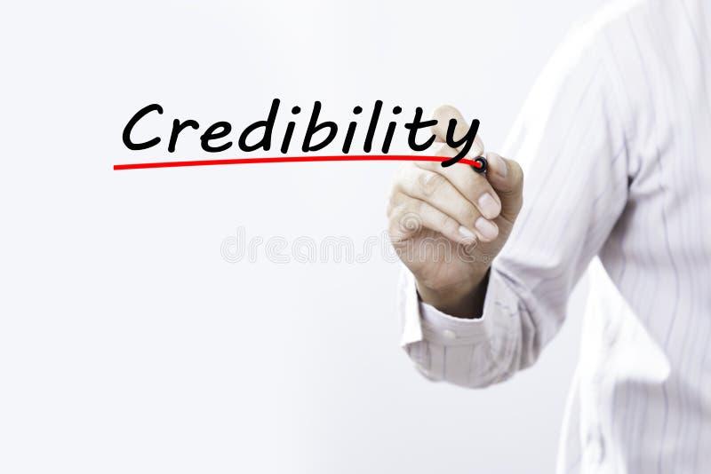 Biznesmen ręki writing wiarygodność z markierem, Biznesowy conce zdjęcie stock