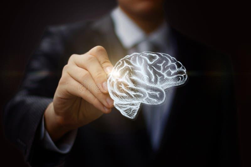 Biznesmen rysuje mózg obraz stock