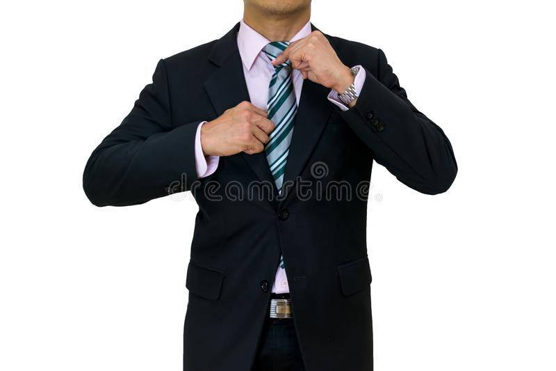 Biznesmen stawia dalej czarnego kostiumu krawata bielu tło zdjęcia royalty free