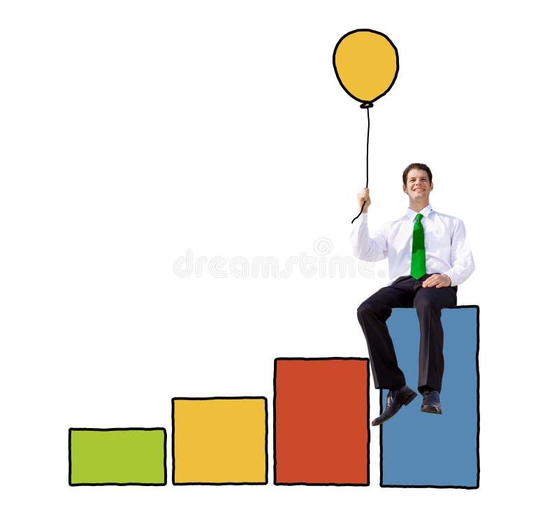 Biznesmen Trzyma balon na Prętowym wykresie fotografia royalty free