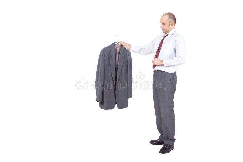 Biznesmen trzyma jego kurtkę obrazy royalty free