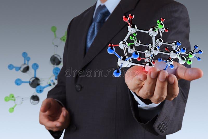 Biznesmen trzyma molekułę zdjęcia stock