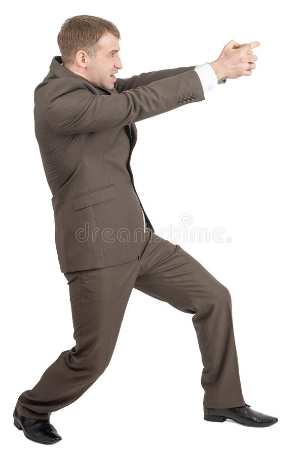 Download Biznesmen Trzyma Niewidzialnego Pistolet Obraz Stock - Obraz złożonej z niewidzialny, ludzie: 65225499