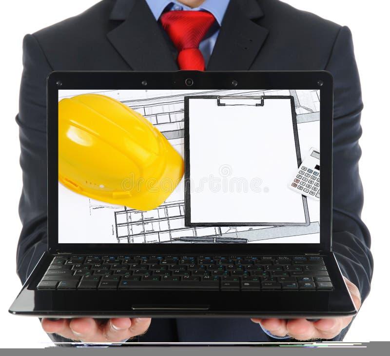 Biznesmen trzyma otwartego laptop zdjęcia royalty free