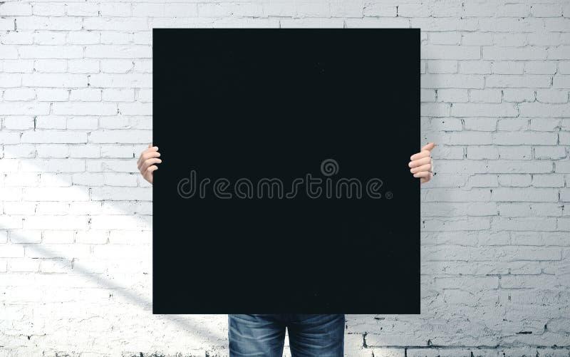 Biznesmen trzymający czarny baner obrazy royalty free