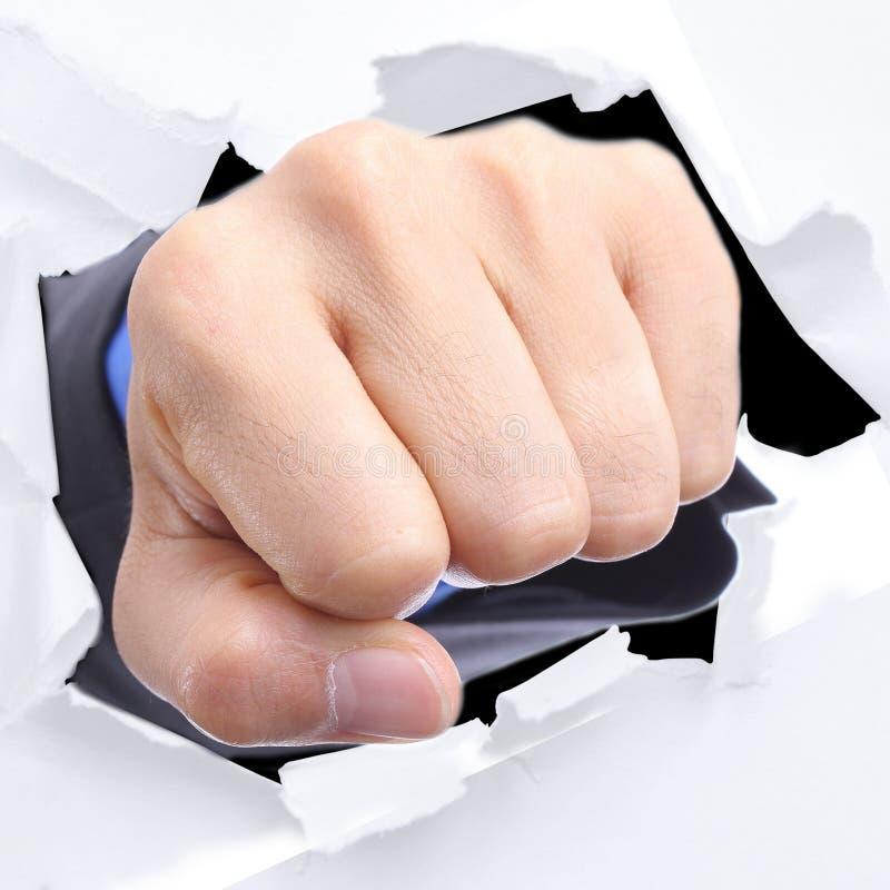 Biznesmen uderza pięścią białego papier obraz stock