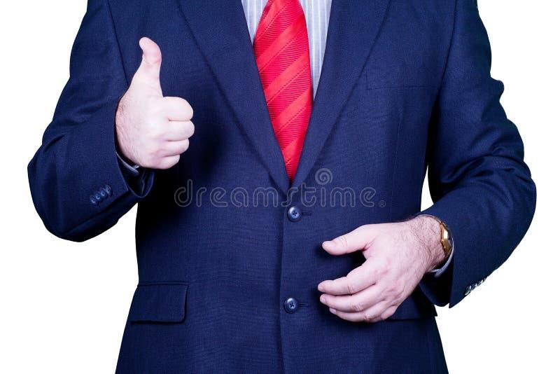 Biznesmen w kostiumu czerwonych krawata mienia aprobatach zdjęcia royalty free