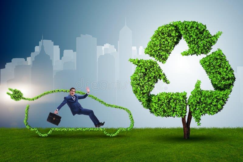 Biznesmen w zielonym elektrycznego samochodu pojęciu zdjęcie royalty free