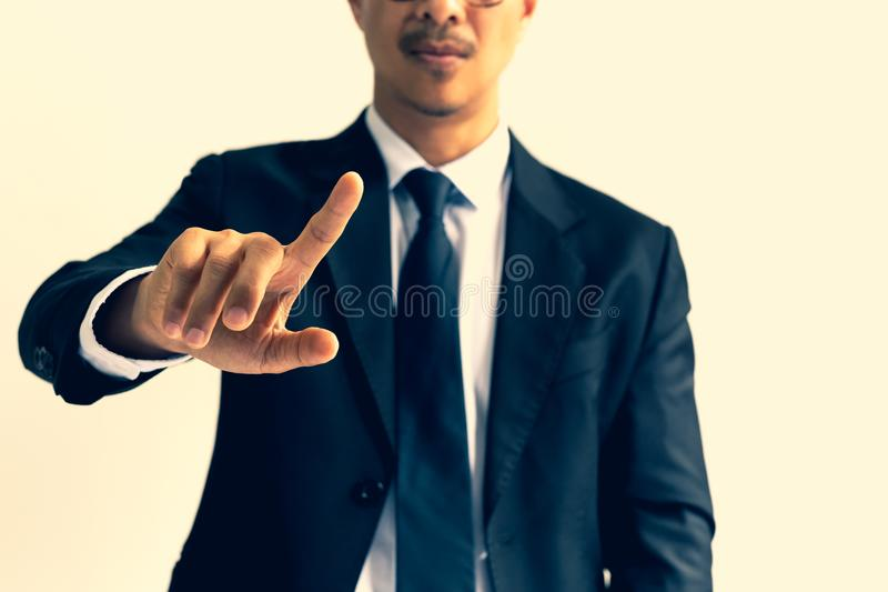 Biznesmen wskazuje jego palec w krzyża procesie fotografia stock