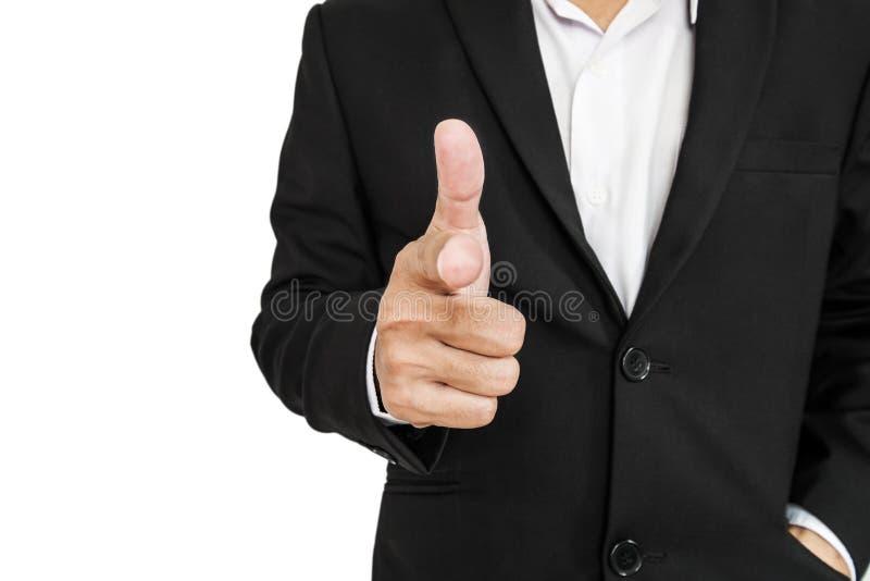 Biznesmen wskazuje ręka pistoletu znaka ekranizować w czarnym kostiumu, selekcyjna ostrość, odizolowywająca na białym tle zdjęcia stock