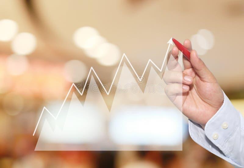 Biznesmen wskazywać w szczycie Biznesowy wykres na abstrakcjonistycznej plamie zdjęcie stock