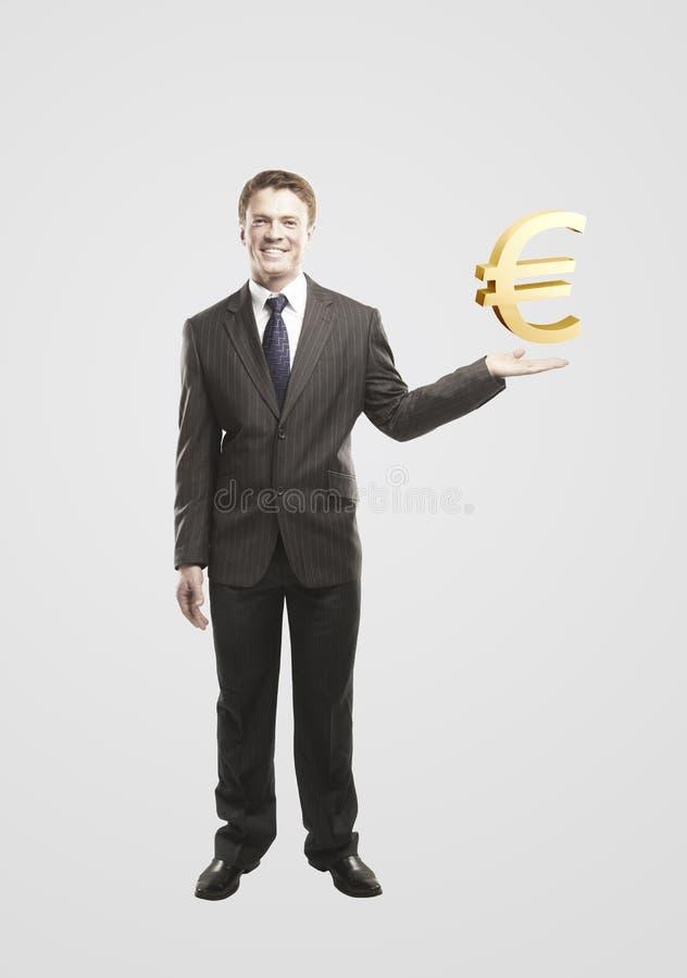 biznesmen wybiera euro złota znaka potomstwa obraz stock