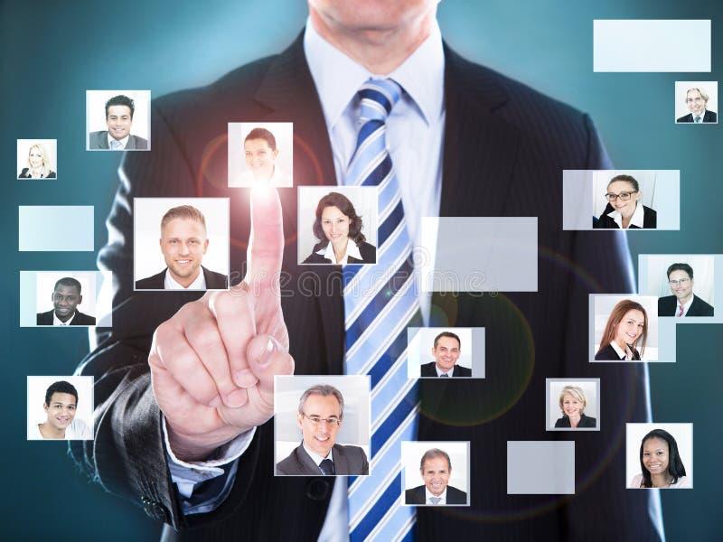 Biznesmen wybiera perfect kandydata dla pracy obrazy stock
