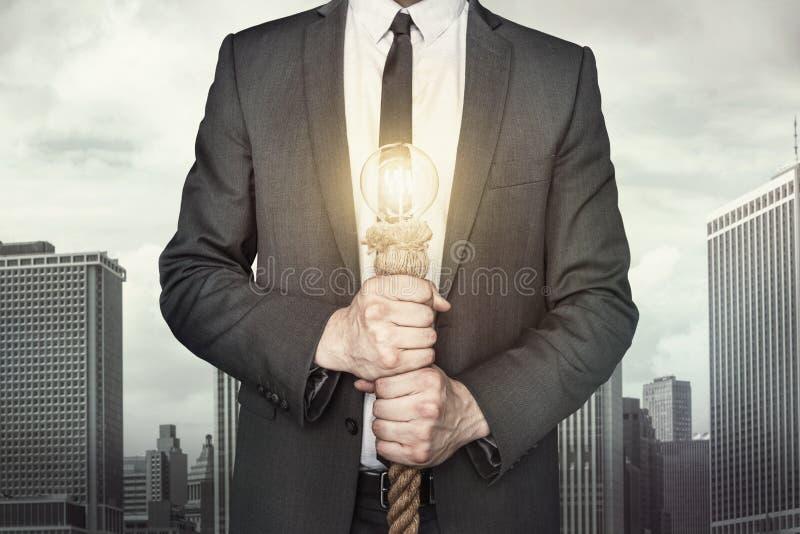 Biznesmen z żarówką zdjęcia stock