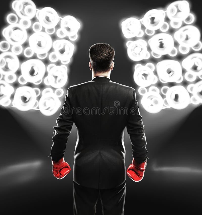 Biznesmen z bokserskimi rękawiczkami fotografia royalty free