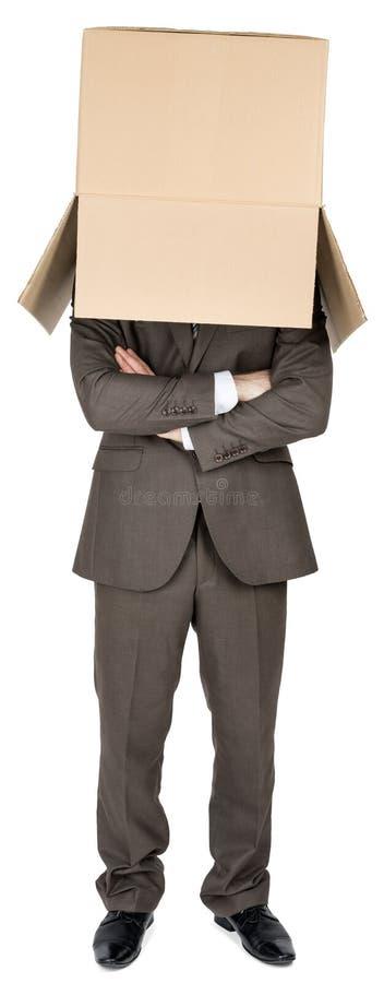 Biznesmen z brązu pudełkiem na jego głowie zdjęcia stock
