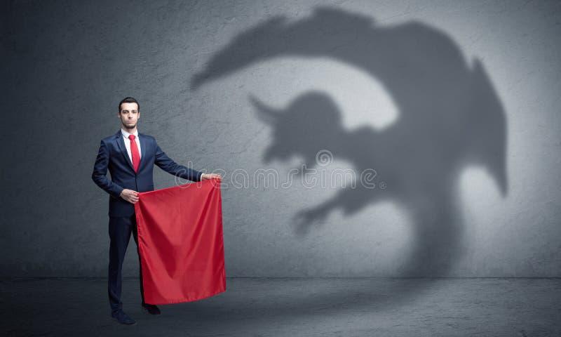 Biznesmen z chochlika toreadora i cienia pojęciem obrazy stock