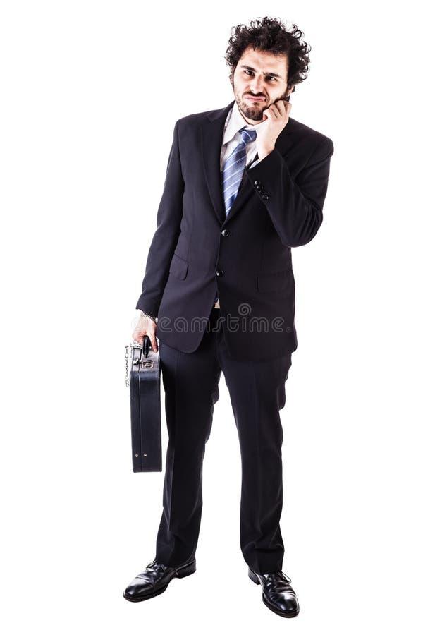 Biznesmen z czarną walizką przykuwającą zdjęcie royalty free