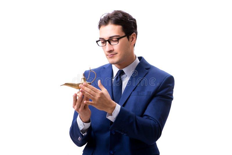 Biznesmen z magiczną lampą odizolowywającą na bielu fotografia stock