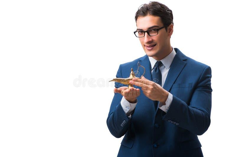 Biznesmen z magiczną lampą odizolowywającą na bielu zdjęcia royalty free