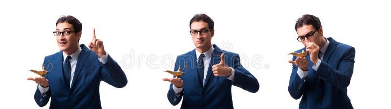 Biznesmen z magiczną lampą odizolowywającą na bielu obrazy stock