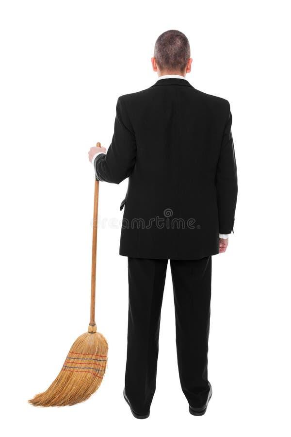 Biznesmen z miotłą obraz stock