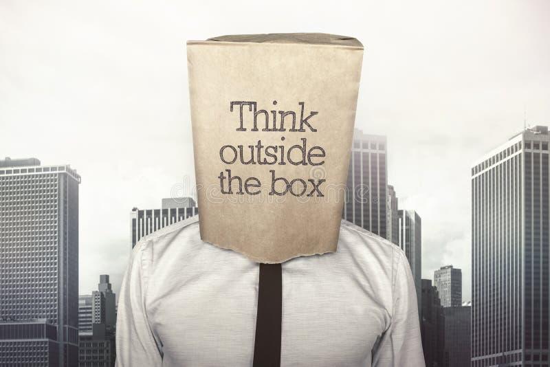 Biznesmen z papierową torbą na głowie zdjęcia royalty free