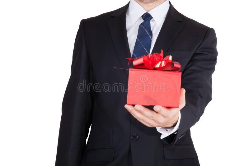 Biznesmen z prezentem zdjęcia stock