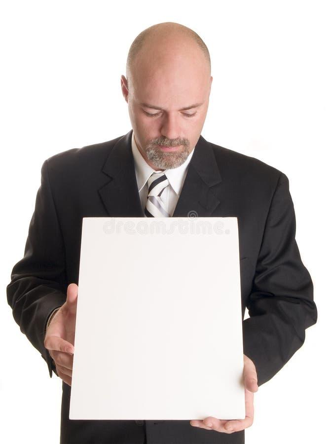 Biznesmen z puste miejsce znakiem obraz stock