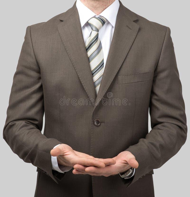 Download Biznesmen z pustymi rękami zdjęcie stock. Obraz złożonej z dorosły - 65225958