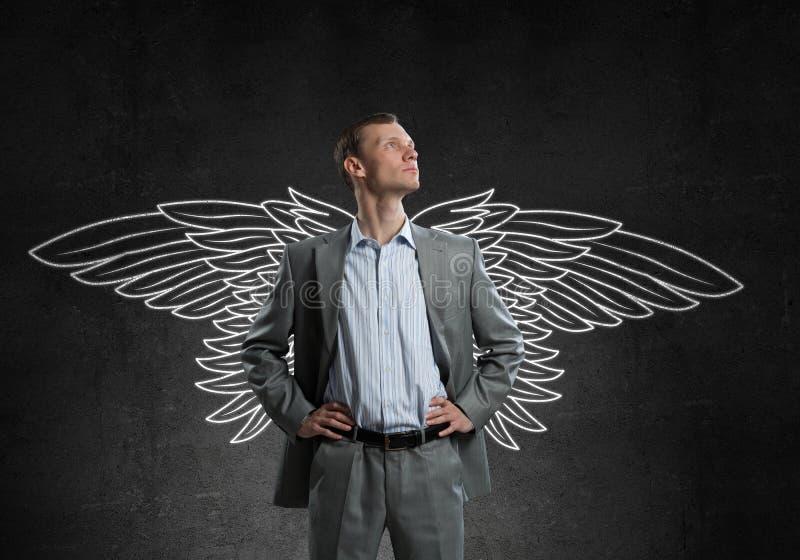 Biznesmen z skrzydłami fotografia royalty free