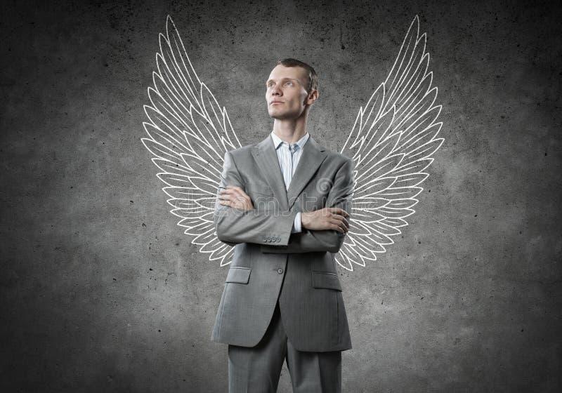 Biznesmen z skrzydłami obrazy royalty free