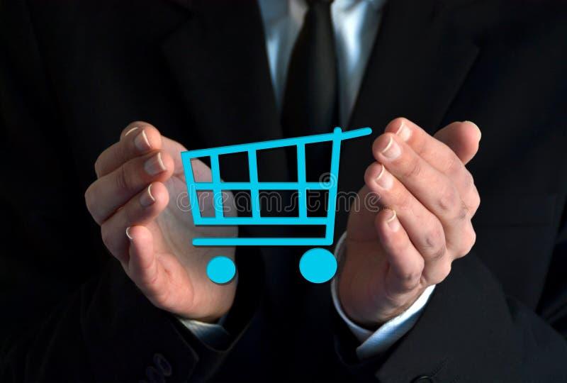 Biznesmen z wózek na zakupy symbolem obrazy stock