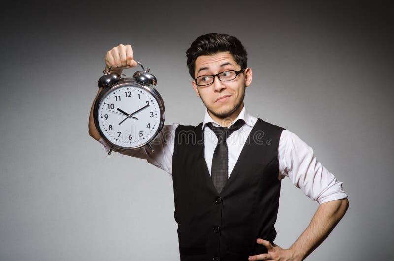 Biznesmen z zegarem obrazy stock