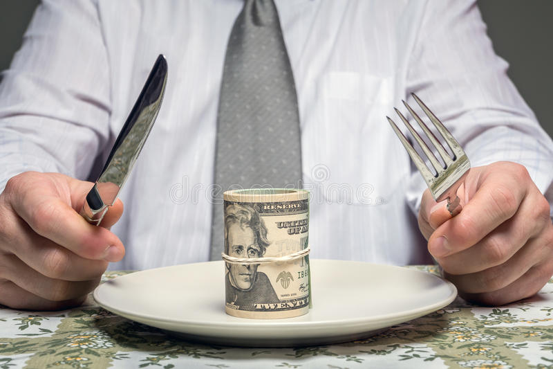 Biznesmen z zwitkiem dolary słuzyć na talerzu fotografia royalty free