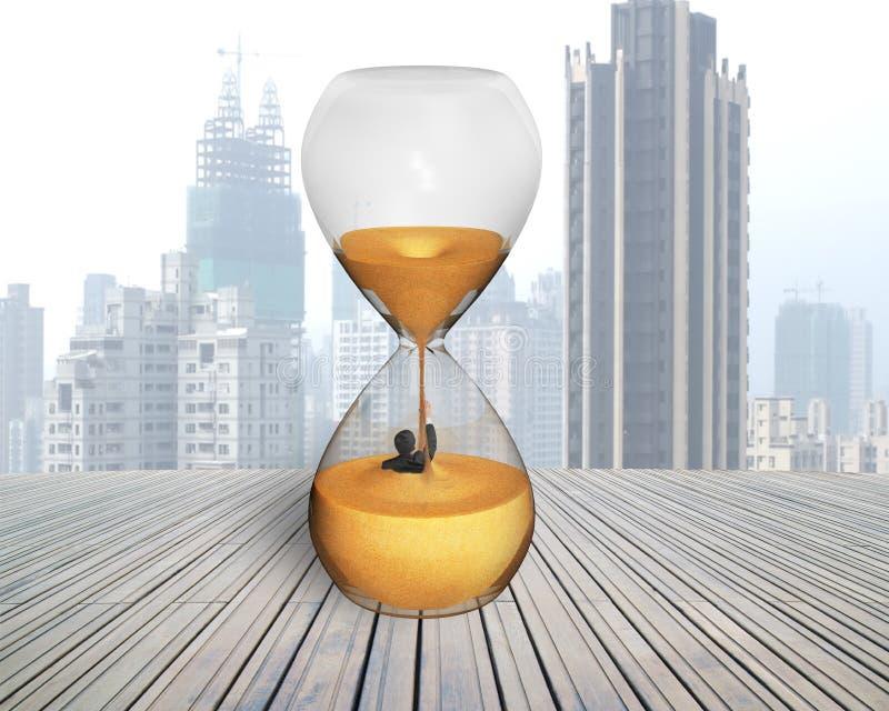 Biznesmen zalewał w piaska zegarze zdjęcia royalty free