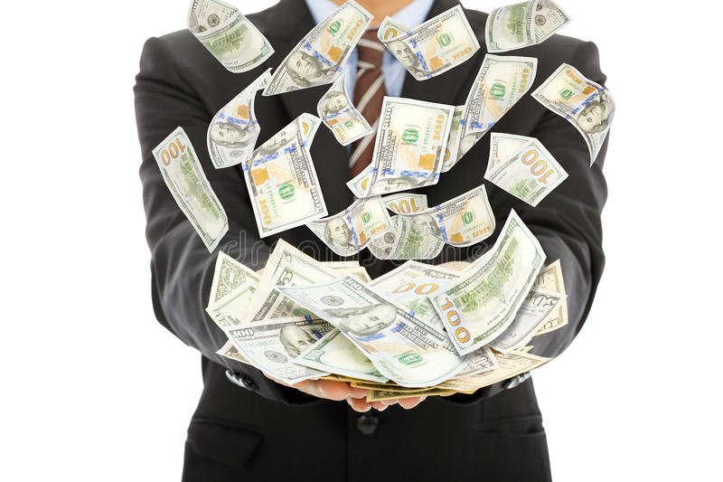 Biznesmen zarabia dolara amerykańskiego z pieniądze deszczem zdjęcie royalty free
