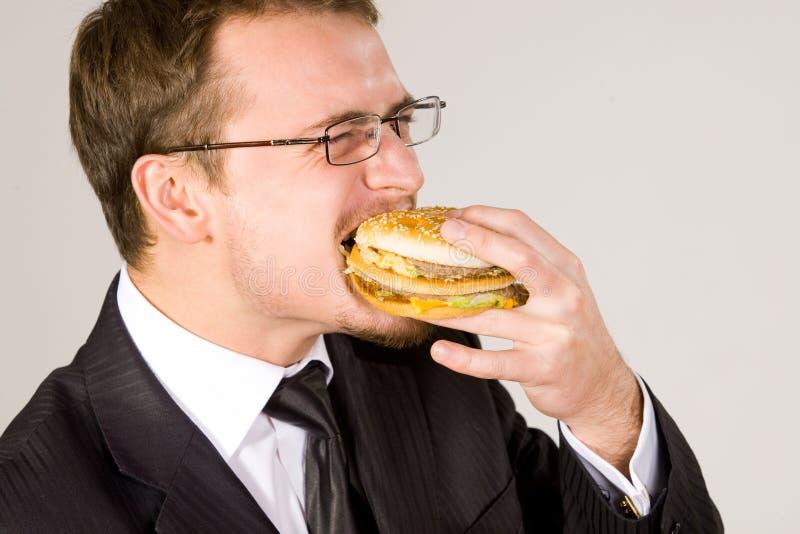 biznesmena łasowania hamburger głodny obraz royalty free