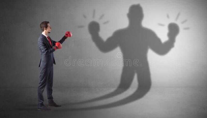 Biznesmena bój z jego nieuzbrojonym cieniem zdjęcia royalty free