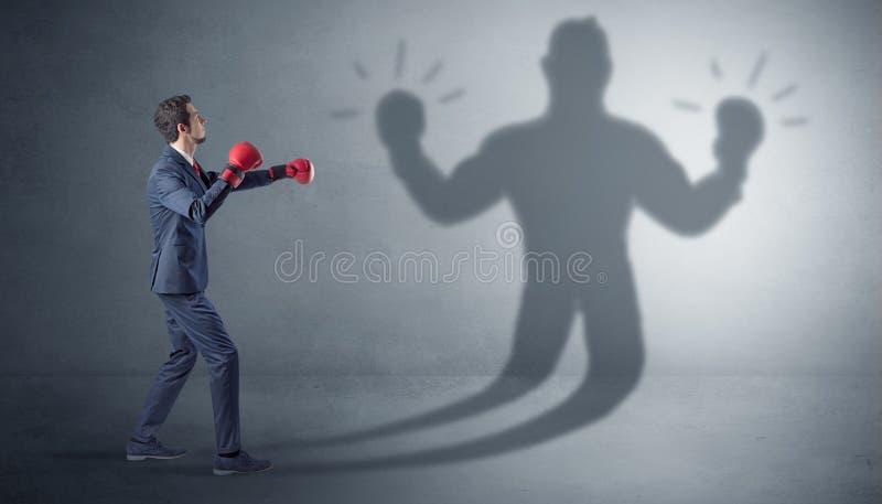 Biznesmena bój z jego nieuzbrojonym cieniem zdjęcie royalty free