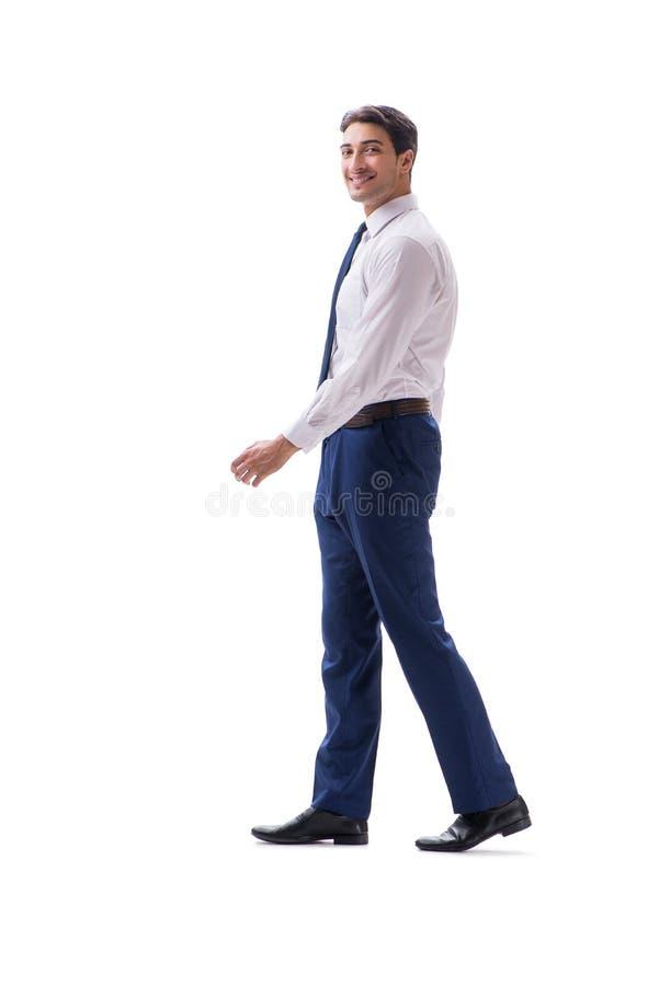 Biznesmena chodzący trwanie boczny widok odizolowywający na białym backgro obrazy stock