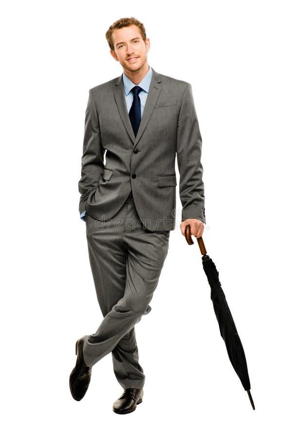 Biznesmena mienia parasolowy ono uśmiecha się odosobniony biały tło obraz royalty free